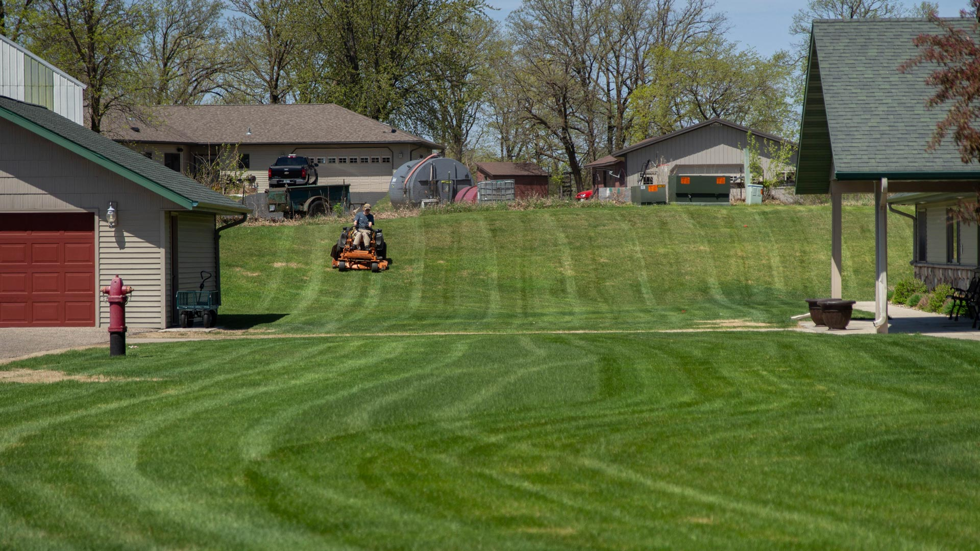 Our team member mowing a residential lawn in Shoreham, MN.