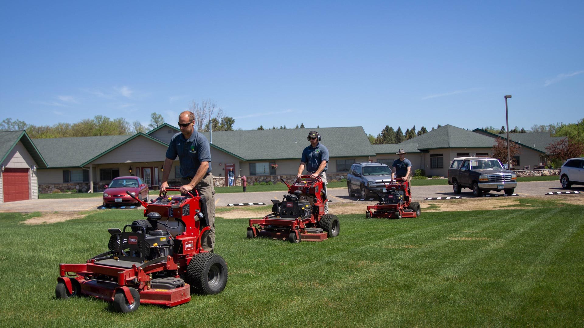 Our team of professionals mowing a large property in Detroit Lakes, MN.