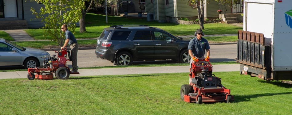 Miller Yard Care & Construction mowing a commercial property in Detroit Lakes, MN.