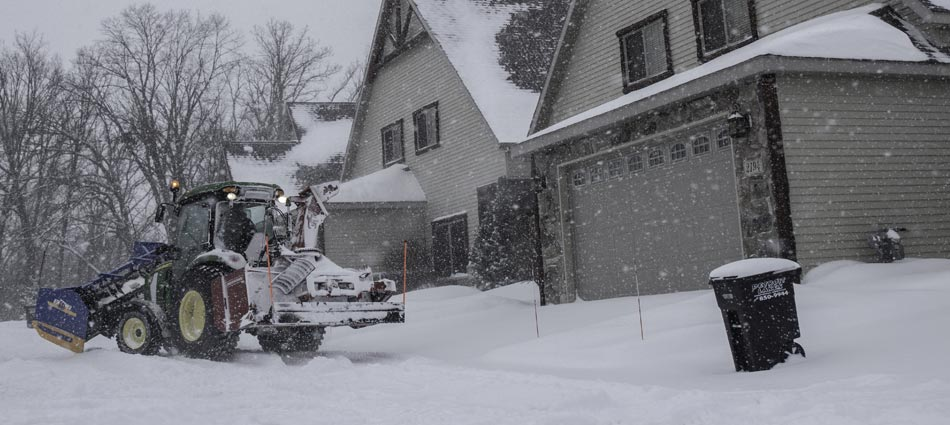 Miller Yard Care & Construction removing snow from a clients home in Minnesota.